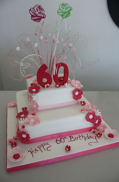 Two Tier White 60th Birthday Cake With Red And Pink Flowers The Number 60 As A Topper