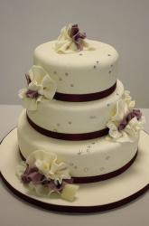 3 tier round elegant ivory wedding cake with ruffles and crystal beads.JPG
