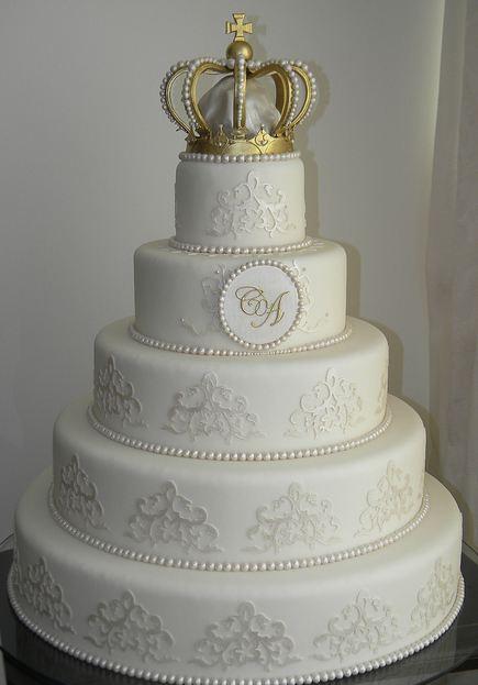 Five tier elegant round white wedding cake with crown on ...
