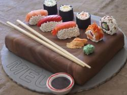 Sushi cake with chopsticks and wasabi and ginger.JPG