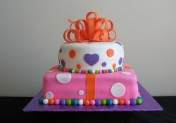 Two tier pink and white birthday cake with orange bow.JPG