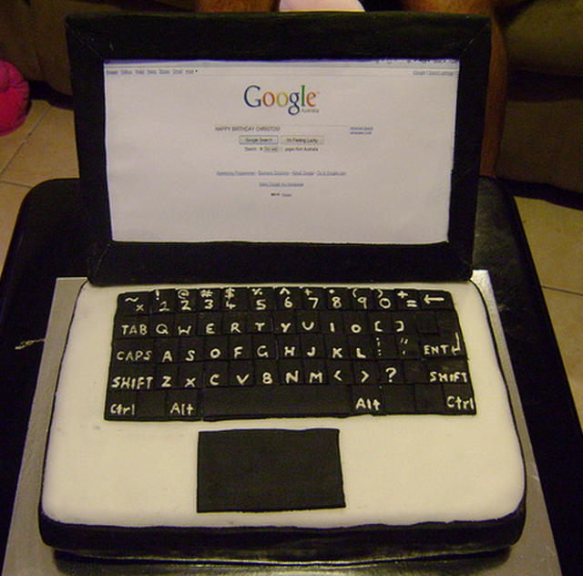 Cool and unique picture of a black and white laptop cake.PNG