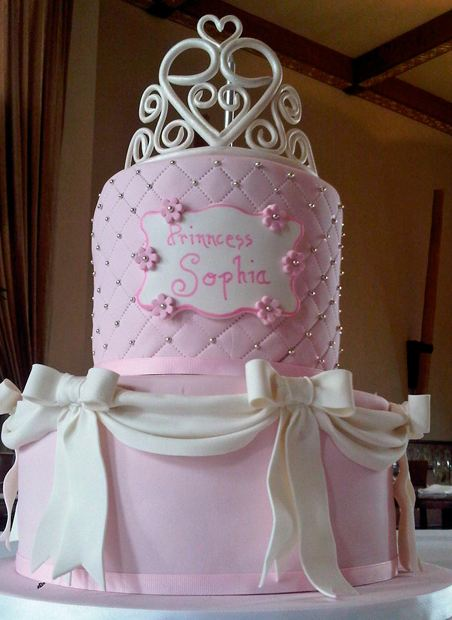 Two tier pink birthday cake with white bows for girl.JPG