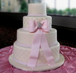 Four tiers engagement cake with big pink bow and crystal and pearl cake decor.PNG