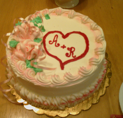 Round engagement cake with heart cake decor.PNG