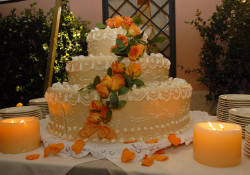 Floral wedding cake with candles.PNG