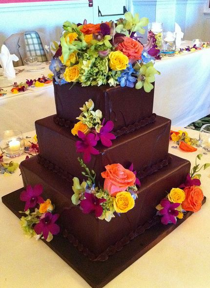 3 tier chocolate square wedding cake with colorful fresh flowers decorating.JPG