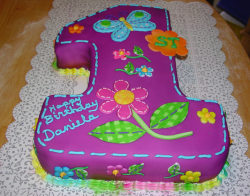 Big purple number one shape cake for first baby first birthday.PNG