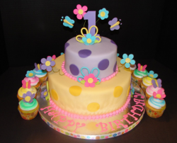 Trendy girl first birthday cake with first birthday cupcakes pictures.PNG