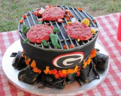 Grill cake with college school rival mascots on grill.JPG