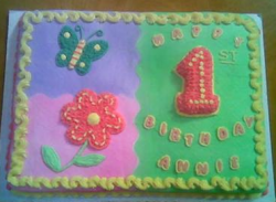 Square first birthday cakes with floral cake decor for girls .PNG
