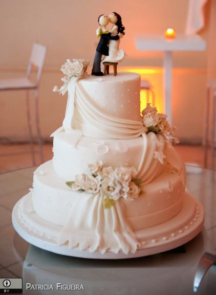 Three Tier White Wedding Cake With Drape And Kissing Bride And Groom ToppersJPG 1 Comment