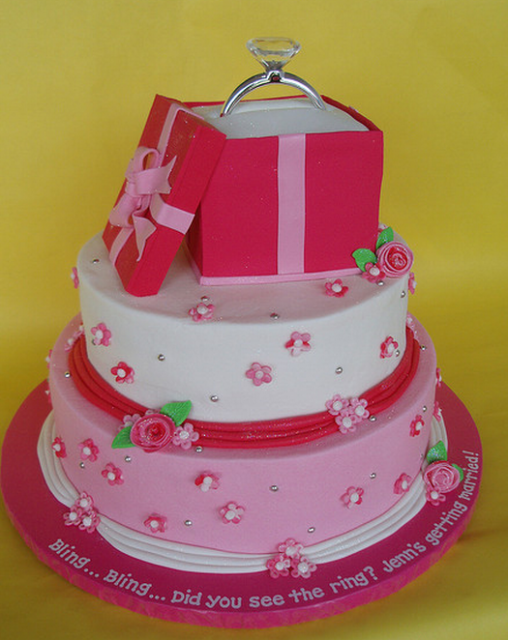 Hot pink engagement cake with engagement ring in gift box cake topper.PNG