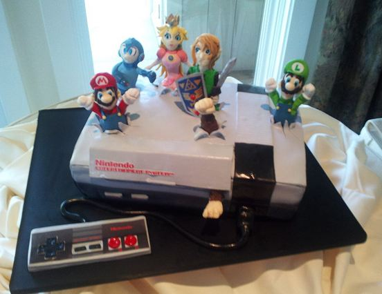 Retro Nintendo console cake with Nintendo characters.JPG