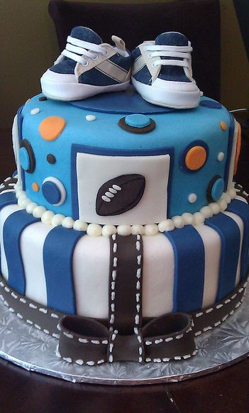 two tier blue and white baby shower cake for boy with little sneakers