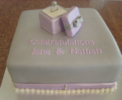 Square engagement cake with pink gift box engagement ring topper pictures.PNG