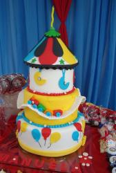 Four tier birthday cake for kids with tent top and toy train and balloons.JPG