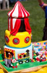 Four tier circus tent cake with clowns and elephant.JPG