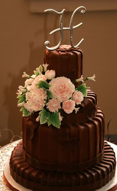 chocolate wedding cake toppers four tier chocolate wedding cake with monogram 12805