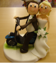 Groom and bride on scooter wedding cakes toppers.PNG