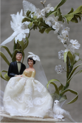 Handmade Vintage Wedding Cake Toppers With White Floral Arch.PNG