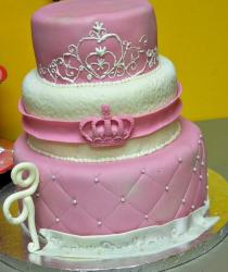 Three tier pink and white cake with crown.JPG