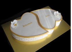 White and gold engagement cakes in heart shape.PNG