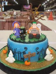 Round blue Halloween cake with ghosts and witch and black cat.JPG