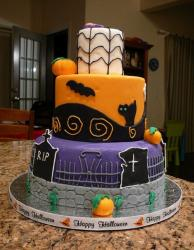 Three tier Halloweencake with graveyard, pumpkins and black cat and tombstones.JPG