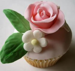 Cupcake with pink rose and green leaves.JPG