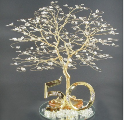 Unique 50 anniversary cake topper picture.PNG