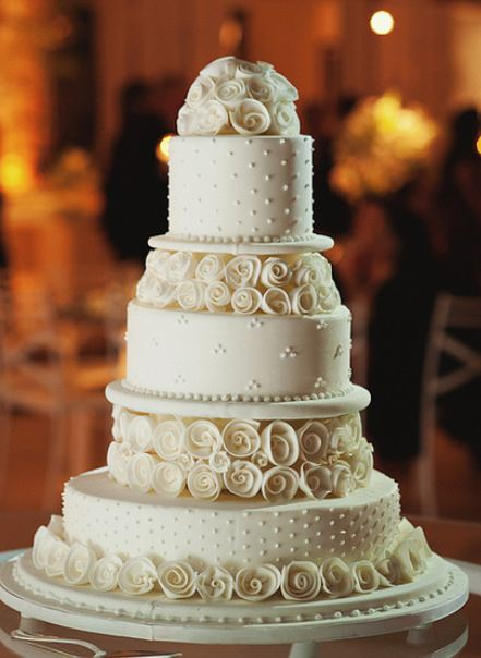 Five Tier Round White Wedding Cake With Roses As Second And Fourth Tiers Topper