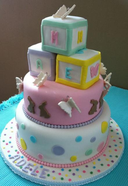 Multiple tier round baby shower cake for girl with baby blocks and butterflies.JPG