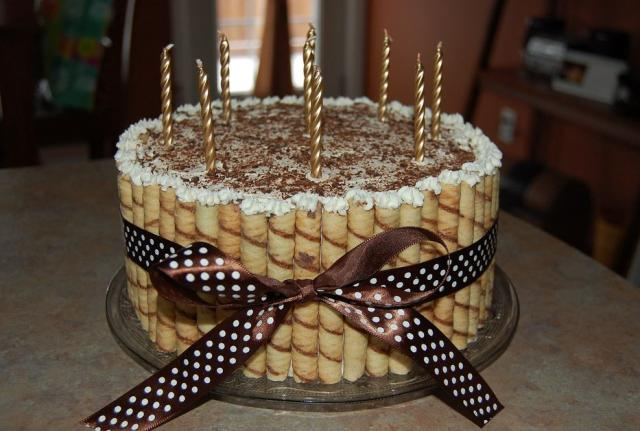 Coffee and chocolate flavored birthday cake with golden ...
