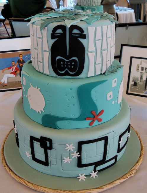 Three tier light blue round wedding cake with tiki and ocean theme.JPG