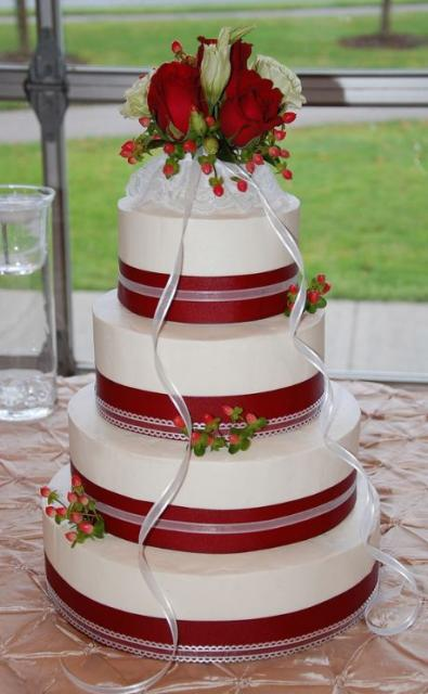 4 tier wedding cake with red roses 4 tier white wedding cake with bands and 10424