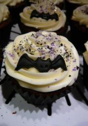 Halloween bat cupcake with white cream.JPG