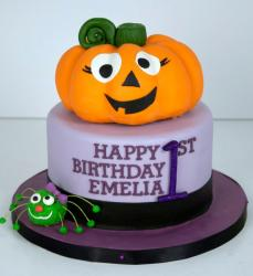 Halloween theme first birthday cake with pumpkin and spider for girl.JPG