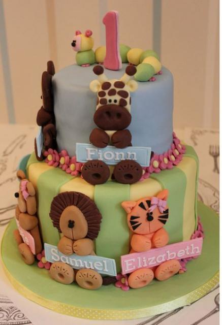 Two tier first birthday cake with animal theme for baby ...
