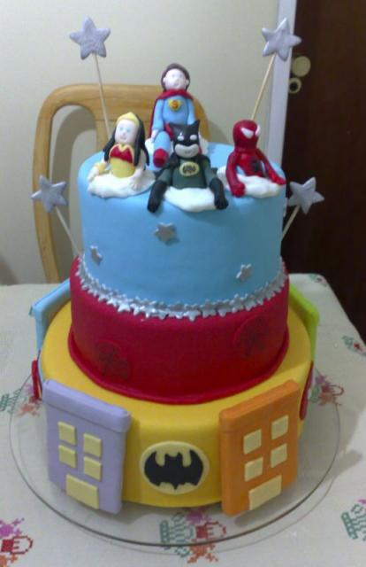 3 tier superhero theme birthday cake with batman, spiderman, superman and wonder woman.JPG