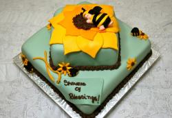 Baby bee 2 tier green baby shower cake.JPG