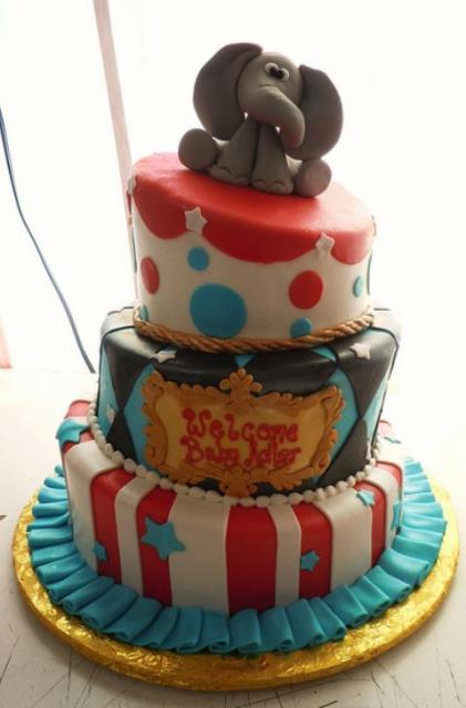 3 tier circus theme baby shower cake with elephant on top.JPG