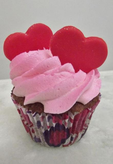 Cupcake with strawberry cream and two red hearts.JPG