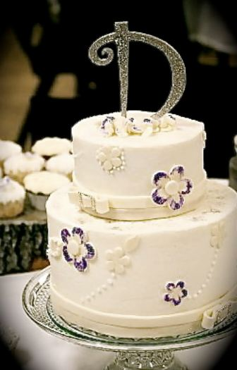 2 tier round wedding cakes pictures 2 tier white wedding cake with large monogram 10136