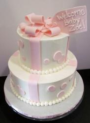Two tier round white baby shower cake with pink bow and tag.JPG