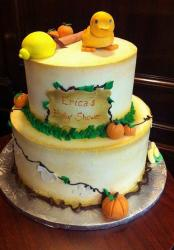 2 tier round white baby shower cake with pumpkins and bird.JPG