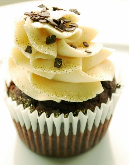 Chocolate Cupcake With White Cream On Top With Chocolate