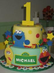 Two tier Sesame Street theme birthday cake for one year old.JPG