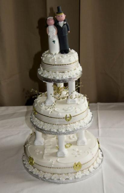 Round 3 Tier Ivory Wedding Cake With Roman Columns Between Each Level And Bride And Groom