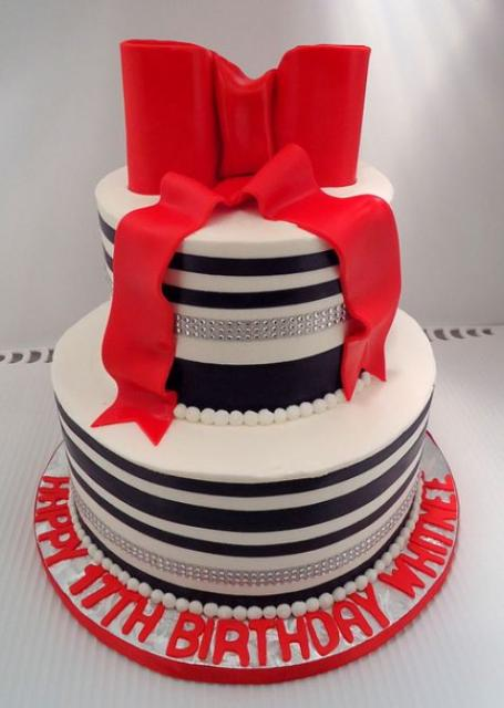 Round 2 tier birthday cake with large red bow and black stripes.JPG (1 ...